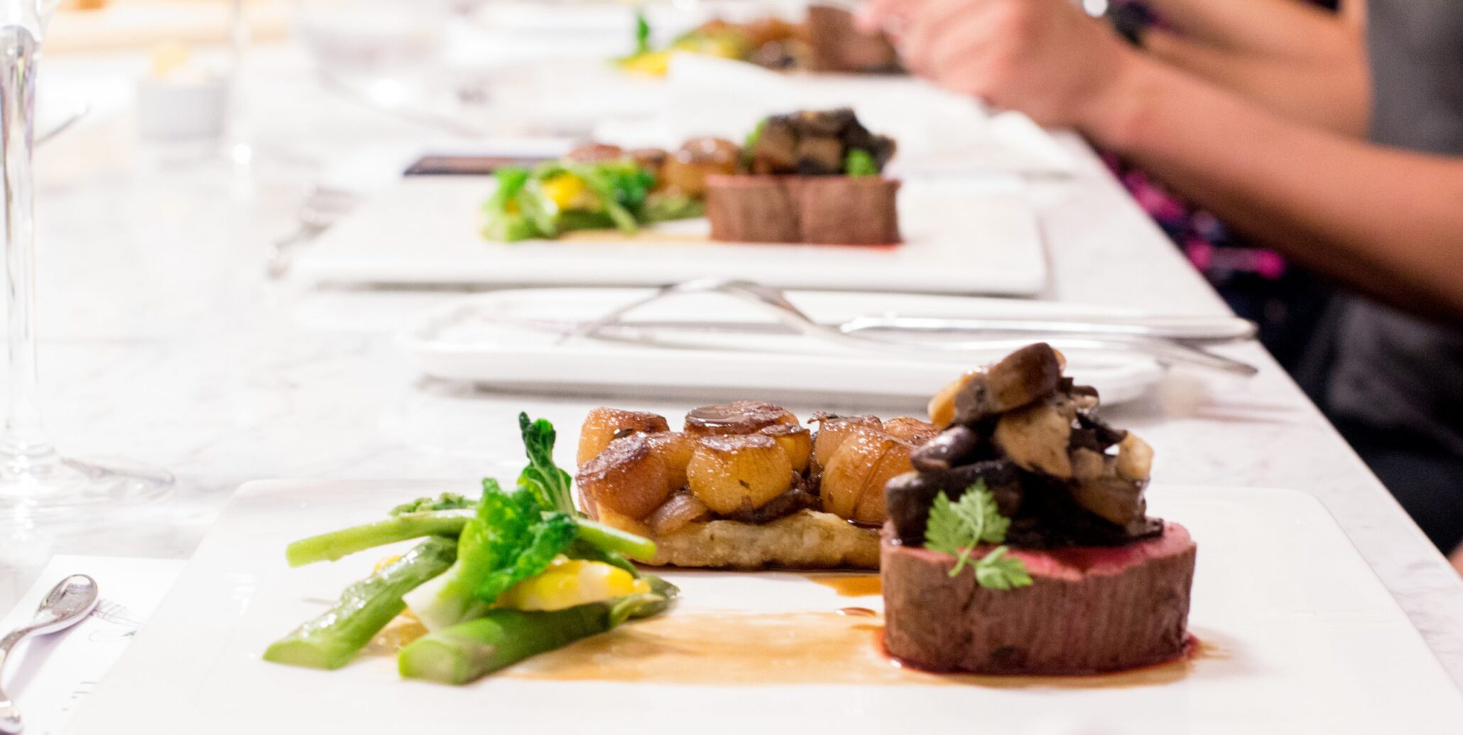 plated food on white table