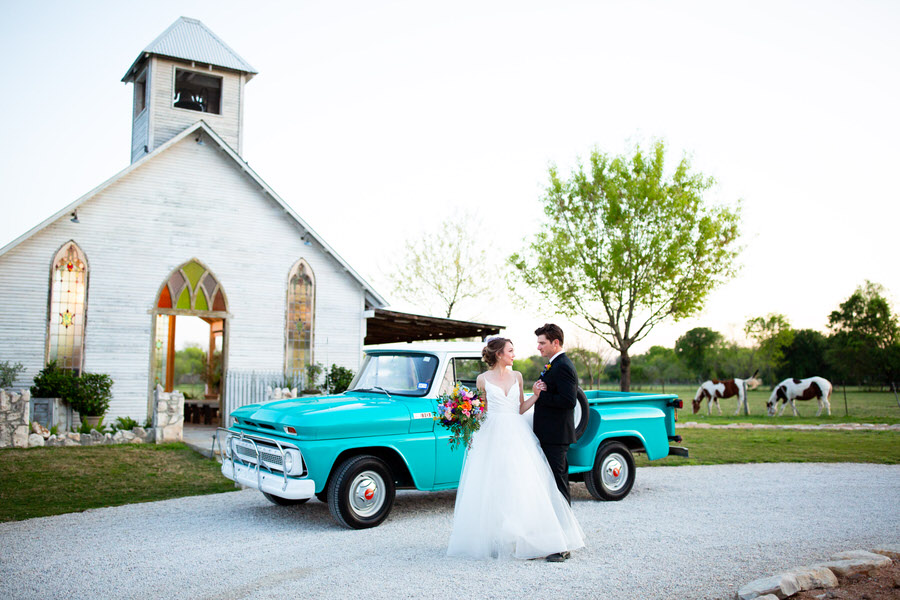 Blue old truck in front of a wedding chapel