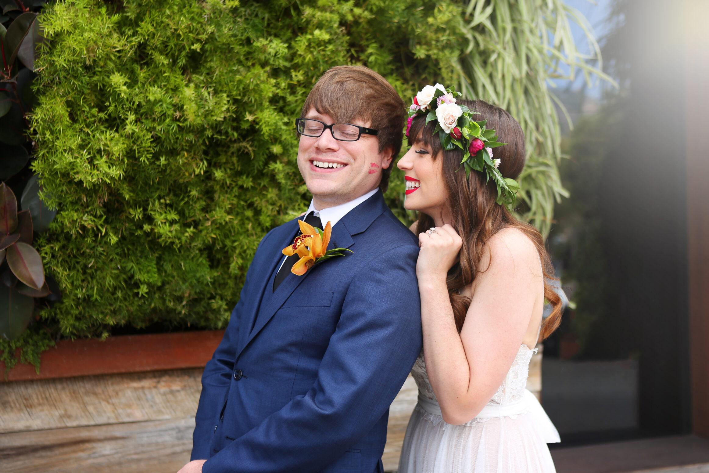 Laguna Beach Bride and Groom Colorful wedding Bride and Groom kiss