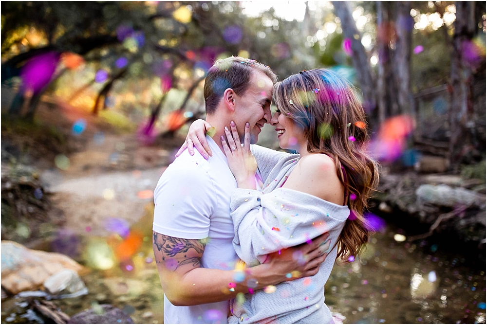 colorful confetti engaged couple cuddle