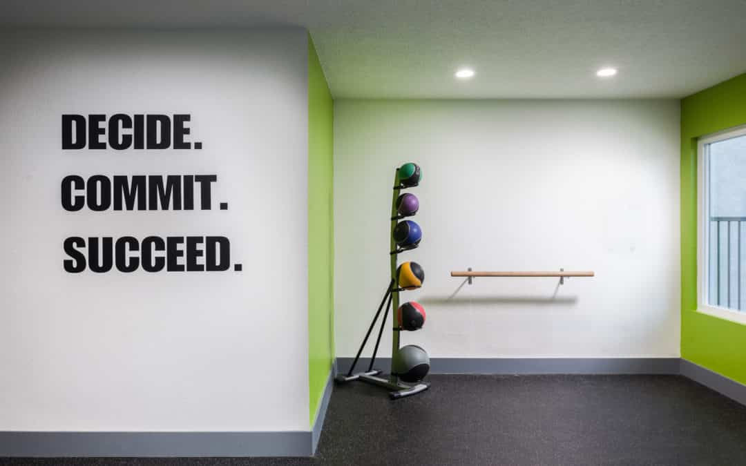 Fitness gym with inspiring quote on the wall