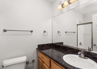 Bathroom with black countertops