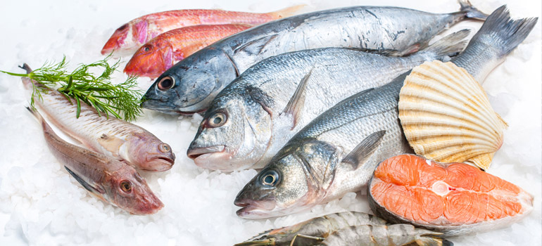 Roasted salmon  & summer veg traybake