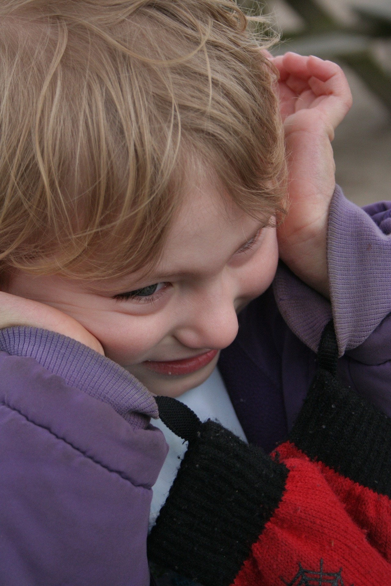 ABA Therapy - A Young Girl Covering Her Ears