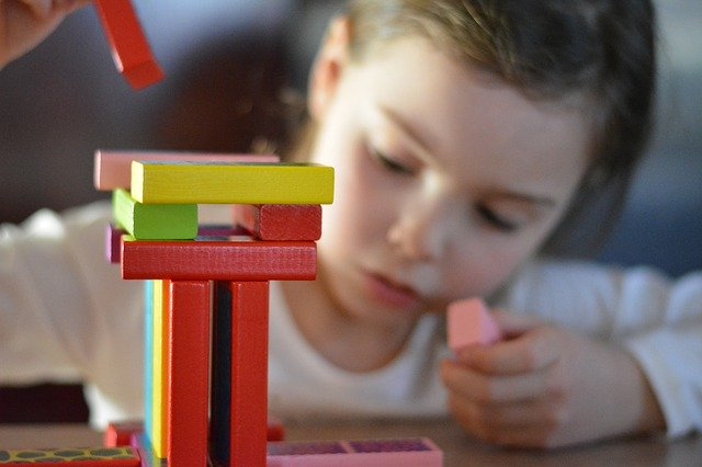 Applied Behavior Analysis - Blog Autism Screening Child Playing Wooden Blocks - Sandcastle Centers