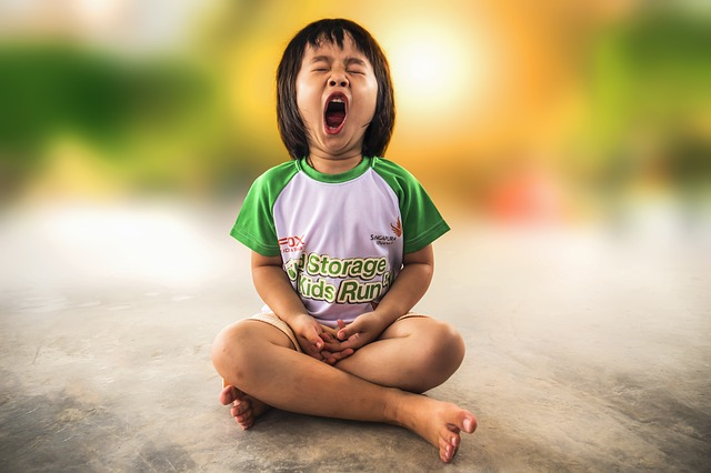 Autism And Sleep - A Child Yawning
