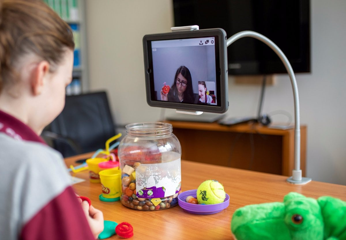 telehealth-a-girl-using-toys-during-a-video-session
