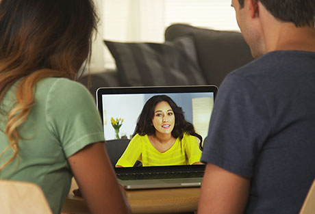 telehealth-two-parents-having-a-video-conference-on-the-coputer-with-a-therapist