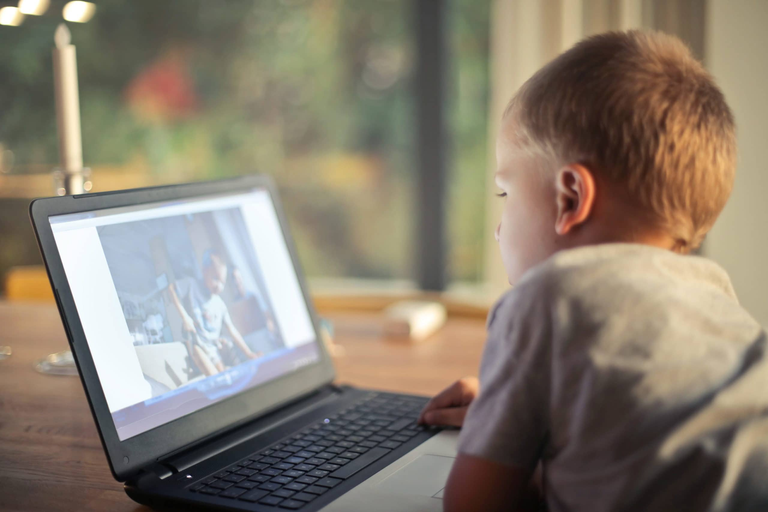 aba-therapy-a-young-boy-watching-a-moving-on-a-laptop