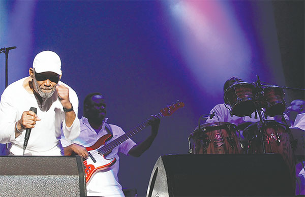 Frankie Beverly, wearing his signature white baseball cap, captivated the audience on Sunday night during Maze's concert at the Peabody Auditorium. Maze continues to be one of the nation's most popular R&B and concert acts even though most of the group's hit songs were recorded in the 1970s and 1980s.(PHOTOS BY DUANE C. FERNANDEZ SR./HARNOTTSPHOTOGRAPHY.COM)