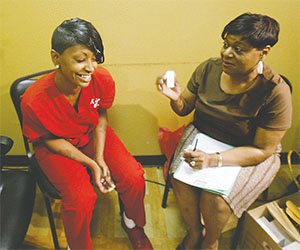 Kim, left, reacts with relief after Roberta McShane shows her the HIV-negative test results. McShane was conducting free HIV tests a few years ago in Arlington, Texas.(AMY PETERSON/FORT WORTH STAR-TELEGRAM/TNS)