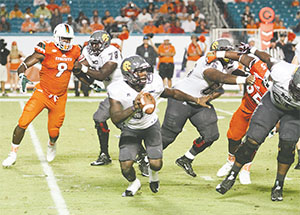 B-CU quarterback Quentin Williams completed 17 of 22 for 244 yards and three touchdowns in the game against Grambling. Above, he is shown during the season opener in Miami.(KIM GIBSON/DAYTONA TIMES)