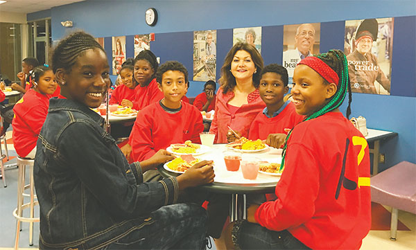 Forough B. Hosseini, center, Food Brings Hope founder and chair, chats with students from Turie T. Small Elementary at Daytona State College's annual holiday concert and dinner.(PHOTOS COURTESY OF FOOD BRINGS HOPE)