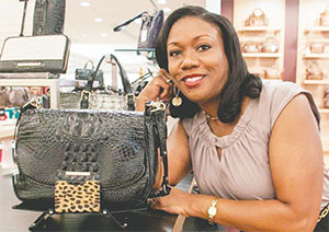 Leslie Johnson Dorsett created Purse Props after attending an event and realized there wasn't a place for her purse. The floor was not an option. The compact style wallet opens up to form a purse stand. (PHOTO COURTESY OF LESLIE JOHNSON DORSETT)