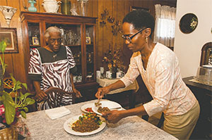 Re Richardson, right, serves a vegan meal of quinoa and sauteed vegetables at her Dallas, Texas home in 2013. Her mother James R. Watson, left, hadn't adopted the vegan lifestyle. (REX C. CURRY/DALLAS MORNING NEWS/TNS)