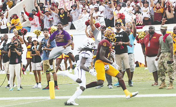 Fans cheer for their teams during the MEAC/SWAC Challenge at Municipal Stadium in Daytona Beach. Because of lightning, the game was halted. It won't be made up. (PHOTOS BY KIM GIBSON)