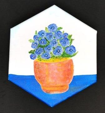 Blue Flowers in Terra Cotta Pot
