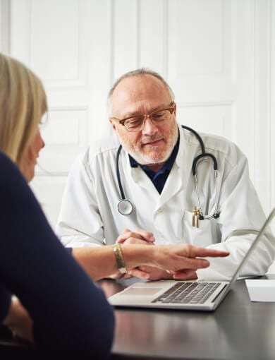Doctor Consulting Patient for PRP Therapy in Atlanta, GA