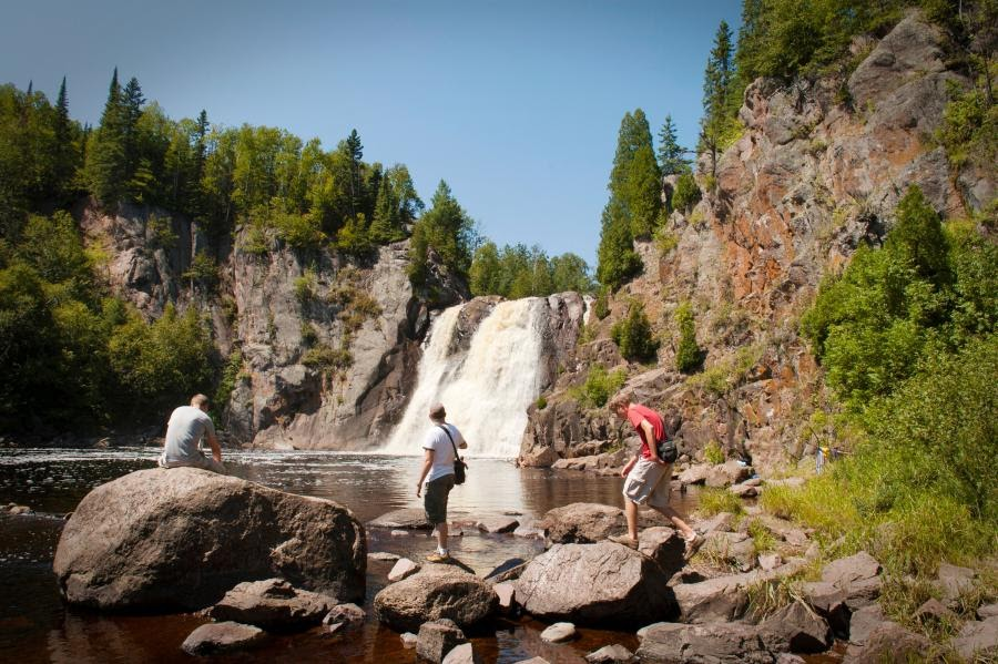 family exploring MN waterfall