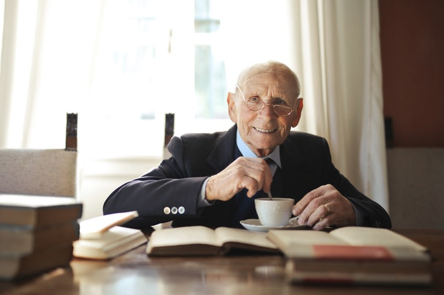 elderly man at table