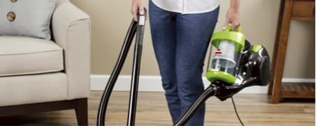 woman with a vacuum in hand