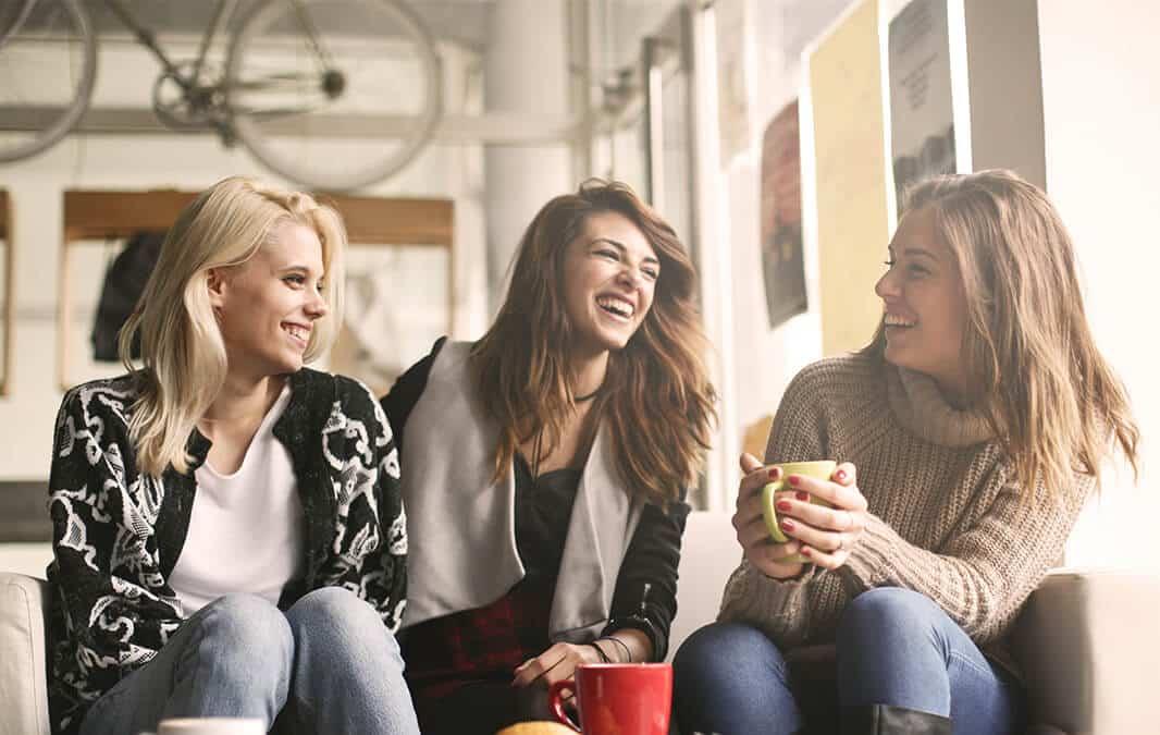 Laughing women while having a coffee break