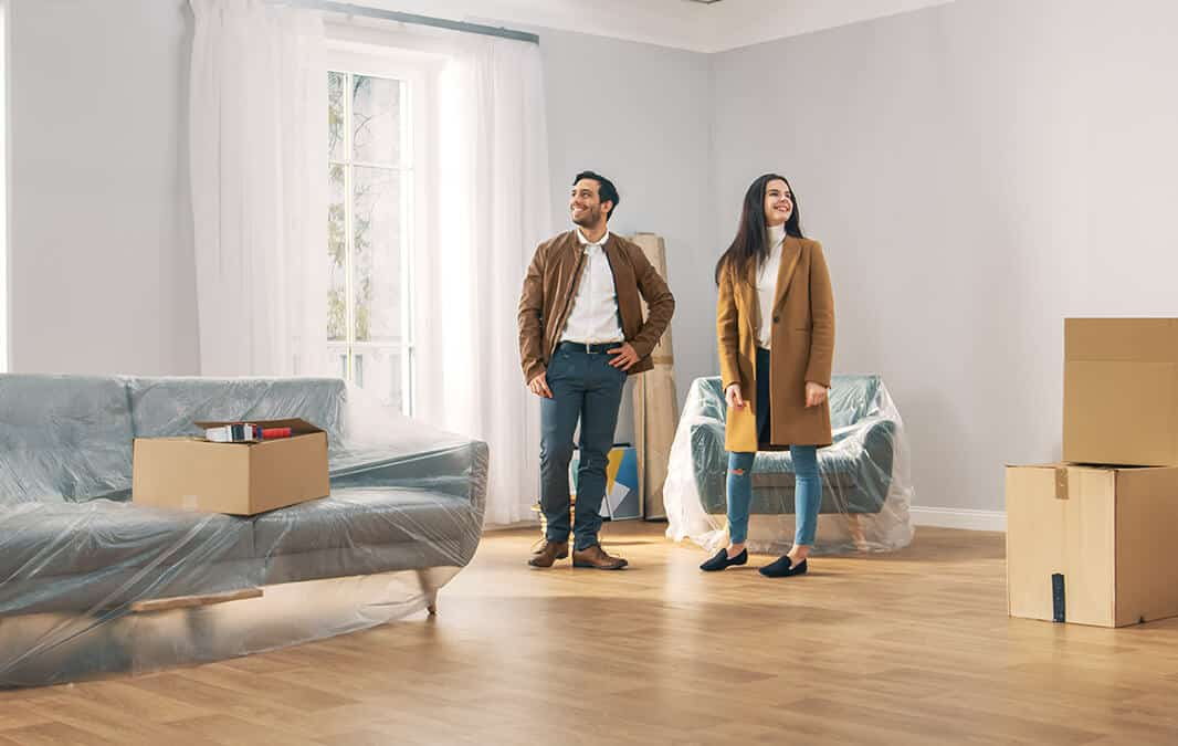 young couple moving in to a new home