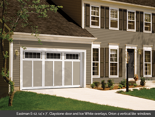 Eastman E-12 Claystone Garaga garage doors with Ice White overlays and Orion 4 vertical lite windows