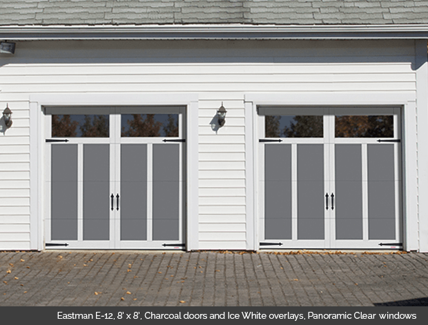Eastman E-12 Charcoal Garaga garage doors with Ice White overlays and Panoramic clear windows