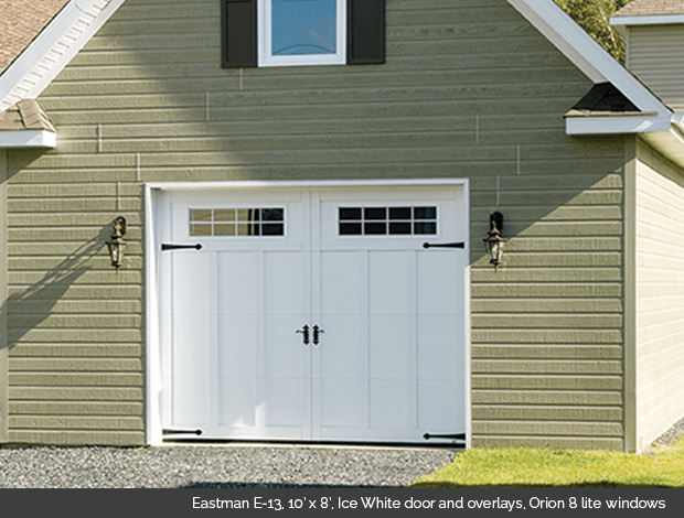 Eastman E-13 Ice White Garaga garage doors with Ice White overlays and Orion 8 lite windows