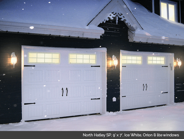 North Hatley SP in Ice White Garaga garage door with Orion 8 lite windows