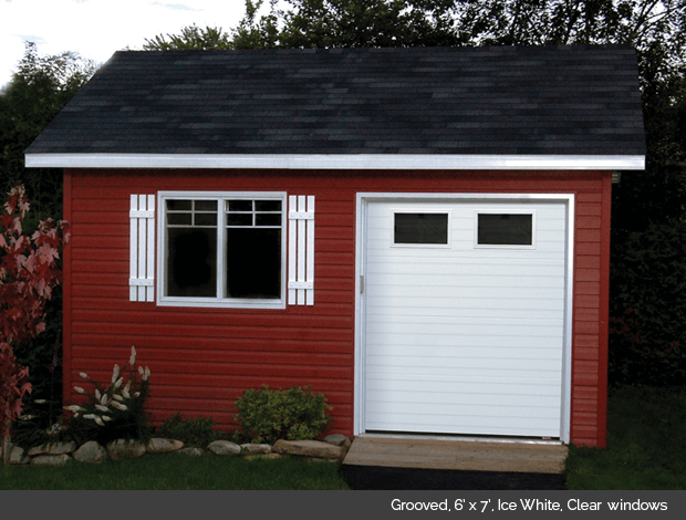 Grooved Garaga garage door in Ice White with Clear Glass windows