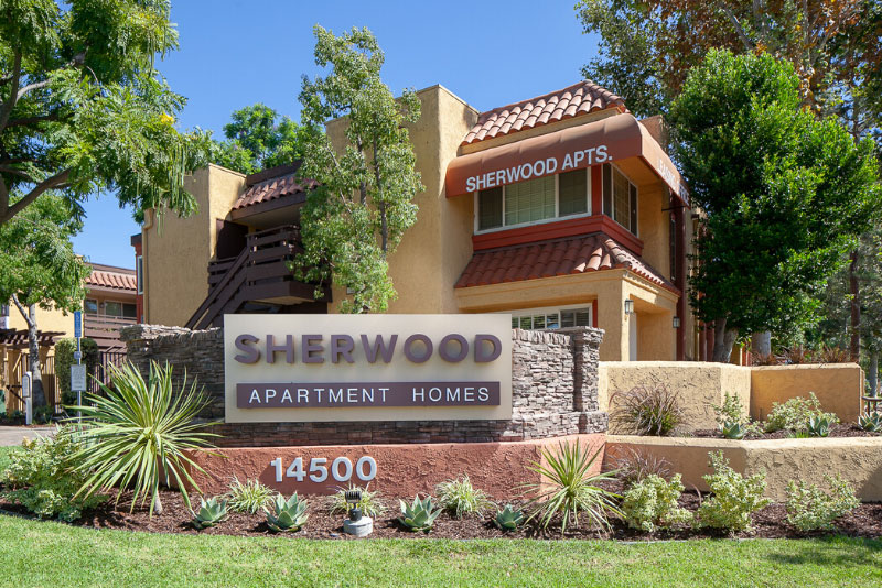 Sherwood Apartment Homes Sign with landscaping