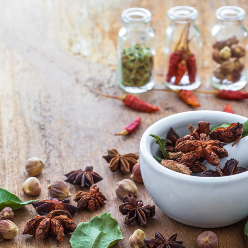 A photo of Mortar Grinder Herb and herbal medicine on wood table, Selective focus, Soft focus