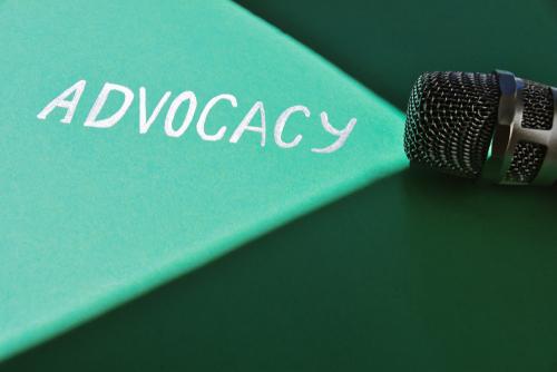 "Flashlight casting light on ""Advocacy"""