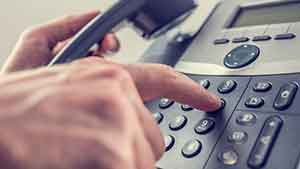 Picture of a man dialing telephone