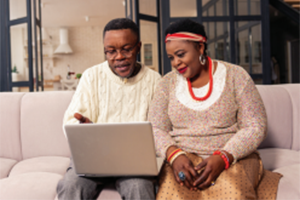 African american couple researching information on the computer