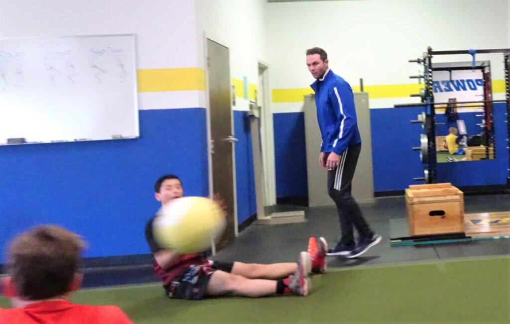 aaron coaching medball throws