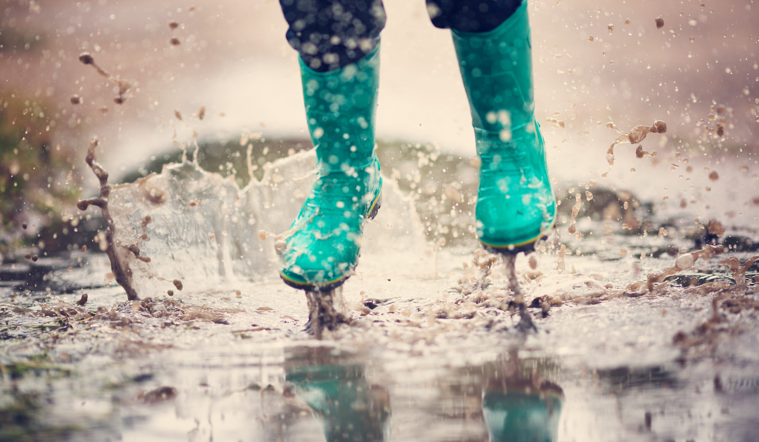 rainboots jumping in a puddle