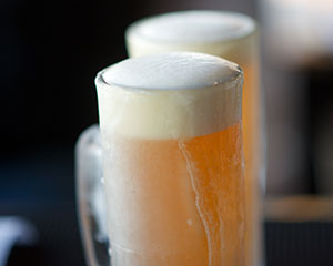 Draft beer in a frosted mug.
