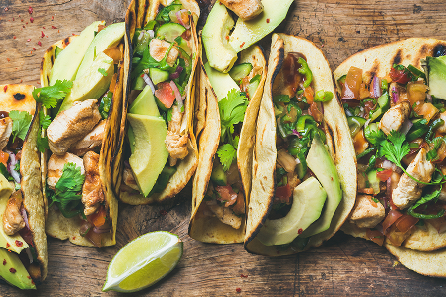 Six Chicken, Green Chili, and Sweet Potato Tacos in a row