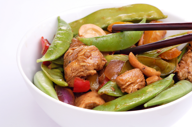 Close up of bowl of Chicken, Snap Pea, and Mushroom Stir Fry