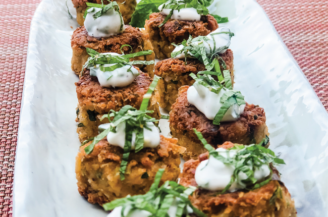 Chickpea Cilantro Lime Fritters lined up in 2 rows on a platter
