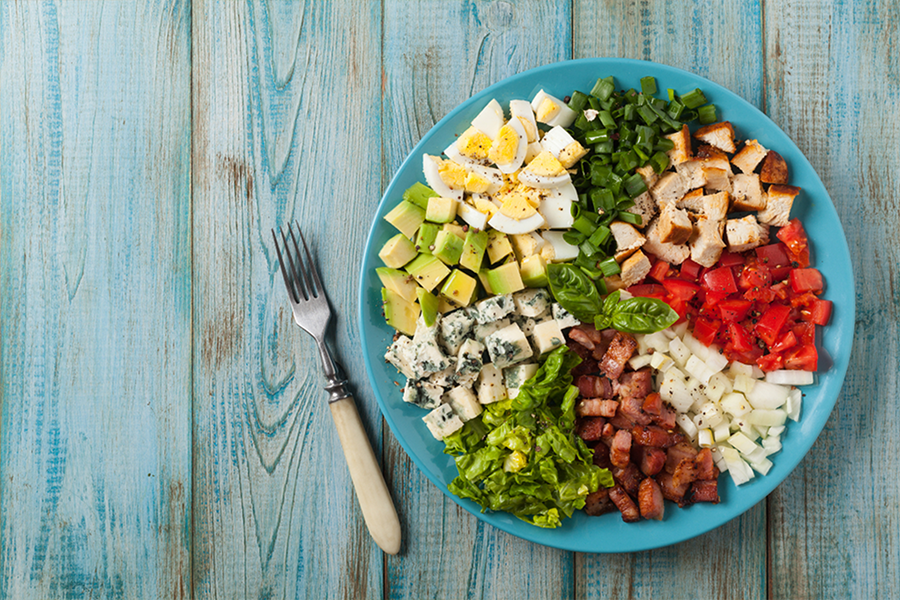 Cobb Salad with chicken, egg, avocado, tomatoes, cheese and other toppings