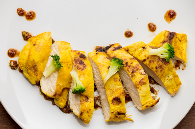 Sliced Coconut, Turmeric & Ginger-Marinated Chicken Breast With Peanut Sauce and broccoli