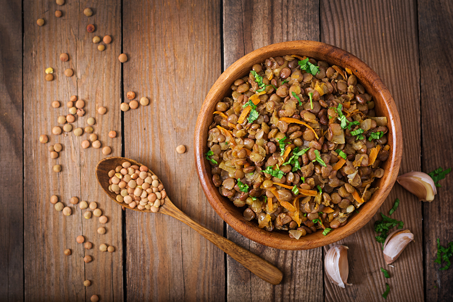 Bowl of Plant-Based Bulgogi Style Lentils with lentils scattered on table