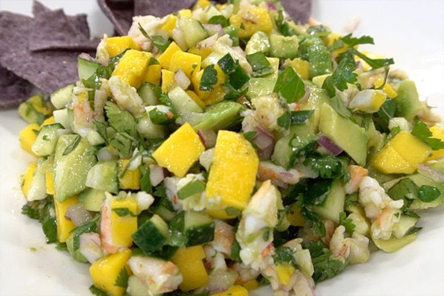 Pile of Shrimp and Mango Ceviche with blue corn tortilla chips
