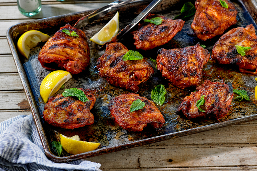 Smoked Paprika and Garlic Dusted Chicken Thighs on a baking sheet
