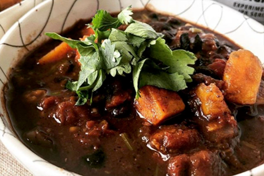 Bowl of Smoky Black Bean, Sweet Potato, and Dark Chocolate Chili
