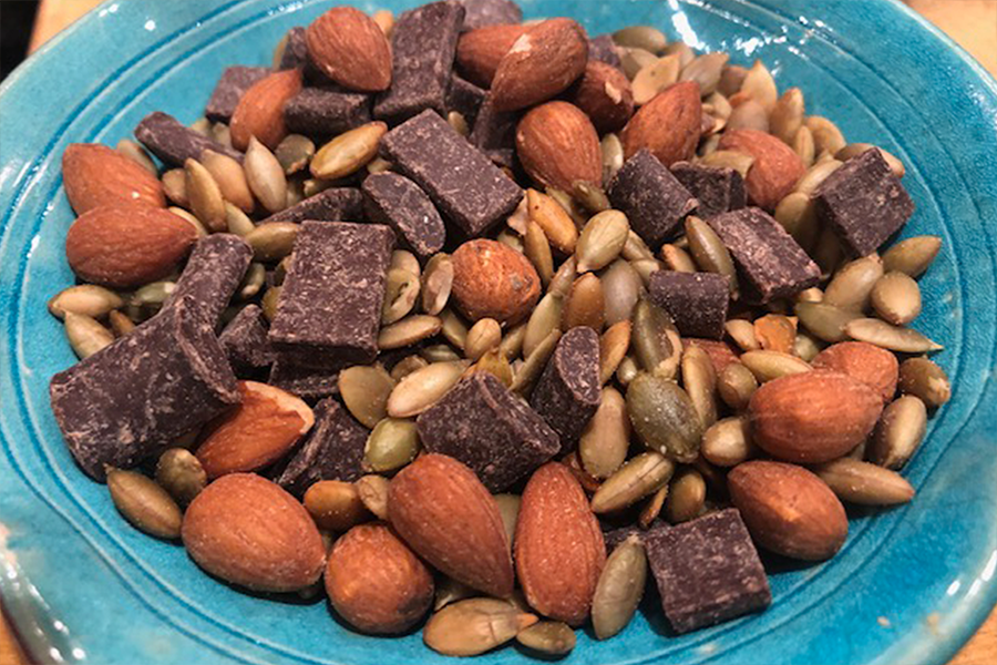 Trail mix with chocolate, almonds and pumpkin seeds